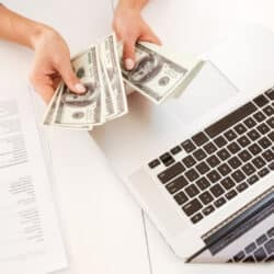 woman learning how to get free paypal money fast and easy