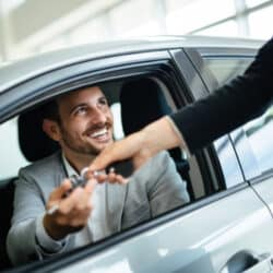 man using free carfax hack to buy a car
