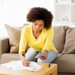 woman using a printable budget planner